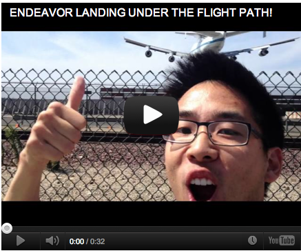 Mike Kai watches right under the flight path as Space shuttle Endeavour arrive at LAX